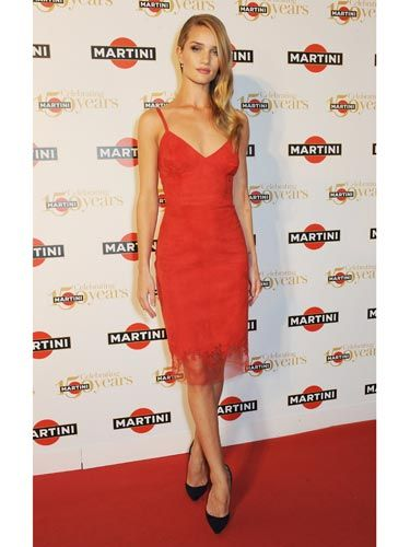 """<p>As to be expected, <a href=""""http://www.cosmopolitan.co.uk/fashion/love/love-it-or-loathe-it-rosie-huntington-whiteley-martini-gala"""" target=""""_blank"""">Rosie HW</a> oozed sex and sophistication at Martini's 150th Anniversary Gala held at Villa Erba overlooking the sensational Lake Como. Her siren-red fitted dress, fifties-inspired <a href=""""http://www.cosmopolitan.co.uk/beauty-hair/news/styles/celebrity/cosmo-hairstyle-of-the-day"""" target=""""_blank"""">hair</a> and signature red lip stole the show. </p>"""