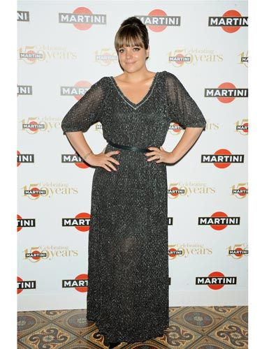 """<p><a href=""""http://www.cosmopolitan.co.uk/celebs/entertainment/lily-allen-new-album"""" target=""""_blank"""">Lily Allen,</a> who performed in the middle of the lake in celebration of Martini's 150th Anniversary last night, sparkled in a floor-length silver-specked gown, cinched at the waist with a thin black belt. </p>"""