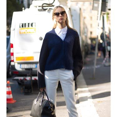 "<p>Model Karolina Kurkova looked city chic wearing Antipodium for <a href=""http://www.asos.com/ASOS/Antipodium-For-ASOS-Climax-Lace-Up/Prod/pgeproduct.aspx?iid=3092082&cid=8337&Rf900=1562&sh=0&pge=0&pgesize=36&sort=-1&clr=Whitenavy"" target=""_blank"">ASOS</a> white lace up shoes with a crisp white shirt and midnight blue buttoned-up cardigan. We love her cats-eye shades as well. </p>