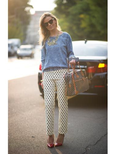"<p>Fashion week regular <span>Wilma Helena Faissol put together the perfect casual outfit, pairing a blue denim-look sweatshirt with cream polka-dot cigarette pants and bright red courts. We love the touch of luxury with her It-bag, sunglasses and gold necklace. </span></p> <p><a href=""http://www.cosmopolitan.co.uk/beauty-hair/news/trends/spring-summer-2014-beauty-trends"" target=""_blank"">BEAUTY TRENDS AT MILAN FASHION WEEK</a></p> <p><a href=""http://www.cosmopolitan.co.uk/fashion/celebrity/emmy-awards-2013-red-carpet-dresses"" target=""_blank"">RED CARPET DRESSES FROM EMMY AWARDS 2013 </a></p> <p><a href=""http://www.cosmopolitan.co.uk/beauty-hair/news/styles/celebrity/frow-hair-celebrity-fashion-week"" target=""_blank"">FRONT ROW HAIR - OLIVIA PALERMO TO ALEXA CHUNG </a></p> <p> </p>"