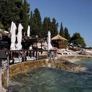 """<p class=""""p1"""">No matter what day it is, come 6pm <a href=""""http://www.hulahulahvar.com/"""" target=""""_blank"""">Hula Hula</a>, perched up on Hvar's rocky coastline, goes mental. Everyone on the island flocks to the rocks to watch the sun sink in to the Adriatic&#x3B; it's the island's best sunset spot. People even cruise in on their yachts from surrounding islands to anchor up and swim to shore for the party, it's that good. </p><p class=""""p1"""">It's a straight from the beach 'swimsuit-chic' kinda place, and anything goes. There's a friendly vibe (sometimes too friendly hey boys?!) so prepare to have a new party gang in no time.</p><p class=""""p1"""">Grab something strong from the bar (the Negroni is a guaranteed pleaser) and either kick back on the loungers, join the party animals and get in to the Euro dancing vibe or hell, even get as naughty as BarChick did and strip off and jump in the sea.</p><p class=""""p1"""">No wonder this is the most popular bar on the island, this place has it all: beats, boys, bikini-clad beach babes and booze.  Start here at 6 and whatever your original intention, every night will become party night. You have been warned. </p>"""