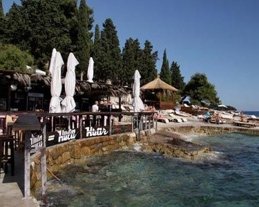 "<p class=""p1"">No matter what day it is, come 6pm <a href=""http://www.hulahulahvar.com/"" target=""_blank"">Hula Hula</a>, perched up on Hvar's rocky coastline, goes mental. Everyone on the island flocks to the rocks to watch the sun sink in to the Adriatic; it's the island's best sunset spot. People even cruise in on their yachts from surrounding islands to anchor up and swim to shore for the party, it's that good. </p> <p class=""p1"">It's a straight from the beach 'swimsuit-chic' kinda place, and anything goes. There's a friendly vibe (sometimes too friendly hey boys?!) so prepare to have a new party gang in no time.</p> <p class=""p1"">Grab something strong from the bar (the Negroni is a guaranteed pleaser) and either kick back on the loungers, join the party animals and get in to the Euro dancing vibe or hell, even get as naughty as BarChick did and strip off and jump in the sea.</p> <p class=""p1"">No wonder this is the most popular bar on the island, this place has it all: beats, boys, bikini-clad beach babes and booze.  Start here at 6 and whatever your original intention, every night will become party night. You have been warned. </p>"