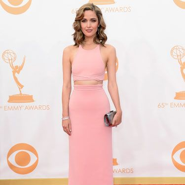 <p>The Bridesmaids star showed off her fine figure (and miniscule waist) in a blush pink column skirt worn with a matching halter neck crop top. Her hair, that was worn with a side parting in 40s-inspired waves, added a new layer of sophistication to the look<br /><br /></p>