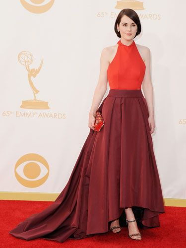 <p>Downton Abbey's Michelle went two-tone with her red dress with a bright halter neck and wine skirt that clashed perfectly. She stopped the dress from swamping her with endless material by having an asymmetric hem that showed off her shoes – nice trick!<br /><br /></p>