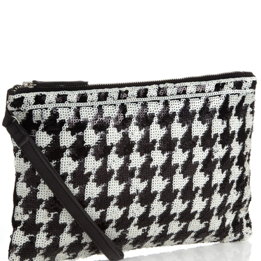 """<p>This sequin clutch is just the right side of snazzy - and the <a href=""""http://www.cosmopolitan.co.uk/fashion/shopping/winter-fashion-trend-2013-checks"""" target=""""_blank"""">checked dogtooth design</a> is totally on point, too.</p><p>Sequin dogtooth clutch, £25, <a href=""""http://uk.accessorize.com/view/product/uk_catalog/acc_17,acc_1.1/4892729000"""" target=""""_blank"""">accessorize.com</a></p><p><a href=""""http://www.cosmopolitan.co.uk/fashion/shopping/the-fashion-fix-shop-bargain-buys"""" target=""""_blank"""">SHOP DAILY FASHION FINDS FOR £10 OR LESS!</a></p><p><a href=""""http://www.cosmopolitan.co.uk/fashion/shopping/winter-fashion-trend-2013-checks"""" target=""""_blank"""">WINTER FASHION TREND: PUNKY PIECES</a></p><p><a href=""""http://www.cosmopolitan.co.uk/fashion/news/"""" target=""""_blank"""">SEE THE LATEST FASHION NEWS</a></p><div style=""""overflow: hidden&#x3B; color: #000000&#x3B; background-color: #ffffff&#x3B; text-align: left&#x3B; text-decoration: none&#x3B;""""> </div>"""