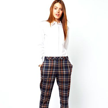"""<p>If you want your tartan to be more traditional toff than punk rocker, opt for a pared-down plaid in a palette of neutral tones. Pair with tweed and heeled loafers for an absolutely spiffing look.</p><p>Tailored tartan torusers, £40, <a href=""""http://www.asos.com/ASOS/ASOS-Trousers-in-Check/Prod/pgeproduct.aspx?iid=3098268&sgid=6659&SearchQuery=check%20trousers&Rf-700=1000&sh=0&pge=0&pgesize=36&sort=-1&clr=Multi"""" target=""""_blank"""">asos.com</a></p><p><a href=""""http://www.cosmopolitan.co.uk/fashion/shopping/winter-fashion-trend-2013-checks"""" target=""""_blank"""">How to wear the check trend this winter</a></p><p><a href=""""http://www.cosmopolitan.co.uk/fashion/shopping/winter-fashion-trend-2013-punk"""" target=""""_blank"""">Punky pieces to shop right now</a></p><p><a href=""""http://www.cosmopolitan.co.uk/fashion/news/"""" target=""""_blank"""">See the latest fashion and style news</a></p>"""