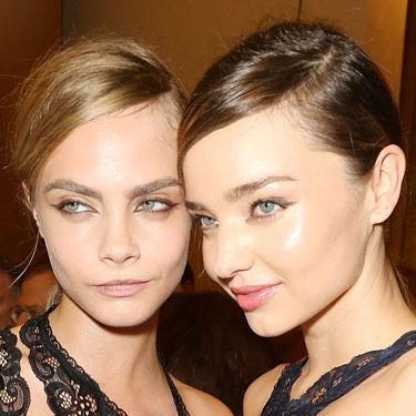 <p>Joining fellow famous model Miranda Kerr, Cara represented the feminine/masculine trend beautifully at Stella McCartney's show during Paris Fashion Week. With preppy partings and tight low ponytails, the hair had an air of androgyny while makeup featured graphic eyeliner for a modern 60s effect.</p>
