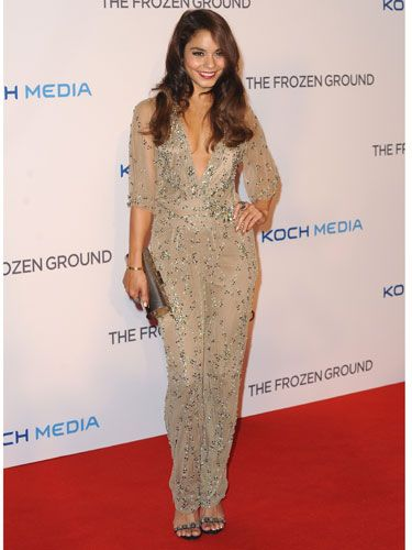 <p>Vanessa channelled Bollywood glamour in this outfit for the Frozen Ground premiere. The champagne-hue and embellished detail of this plunge-neck jumpsuit was sophisticated yet sexy and the dark caramel tones of her hair worked perfectly with this outfit.</p>