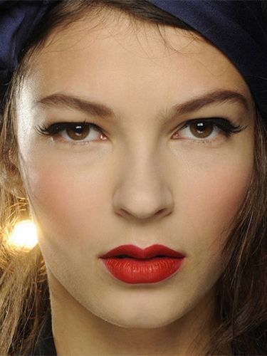 "<p><strong>The makeup look:</strong> ""A 1950s pin-up beauty…think Dita Von Teese, but in a naughty way, a pin-up that danced to much and is back from the party"" said Makeup Artist Carole Colombani using MAC.</p> <p><strong>The products:</strong> Face - Pinch Me Powder Blush blended over the centre of cheeks for a healthy flush. Eyes - Veluxe Brow Liner used to define the brows in a ""retro"" way: Perfected two-thirds of the way starting at the inner brow, then sketched in a broken line after the arch before being brushed upwards, lifting the brow. Blacktrack Fluidline drawn through the upper lashline starting at the extreme inner corner and extending outwards to lift and elongate eyes. False Lash Black Mascara blended through the upper lashes only to lengthen and define. 20 Lash half-demis applied above the outer corners of lashes to extend and lift eyes with a beautiful flick. Lips - MAC PRO Crimson and Red Lipmix mixed together for intensity. MAC PRO Basic Red Chromagraphic Pencil used to define, creating a slightly bigger and fuller lower lip to finish.</p>"