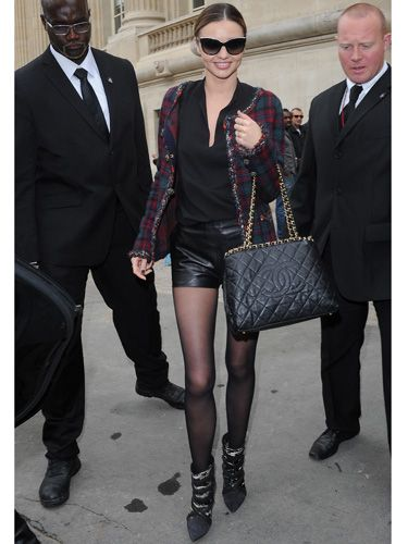 "<p>Model Miranda Kerr looks just as stylish off the catwalk as on it, wearing off-duty grungy <a href=""http://www.cosmopolitan.co.uk/fashion/shopping/tartan-trousers-winter-fashion-trends-2013"" target=""_blank"">tartan</a> and leather.</p>