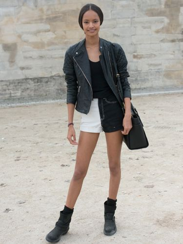 "<p>Model Malaika Firth is channelling her inner rock chick, toughening up her two-tone denim shorts with a quilted leather jacket and a heavy biker boots. </p> <p><a href=""http://www.cosmopolitan.co.uk/fashion/shopping/cosmopolitan.co.uk/fashion/shopping/milan-fashion-week-street-style"" target=""_blank"">Milan Fashion Week street style</a></p> <p><a href=""http://www.cosmopolitan.co.uk/fashion/shopping/cool-street-style-at-london-fashion-week"" target=""_blank"">London Fashion Week street style</a></p> <p><a href=""http://www.cosmopolitan.co.uk/fashion/winter-fashion-trends-2013/"" target=""_blank"">See the latest winter fashion trends</a></p>"