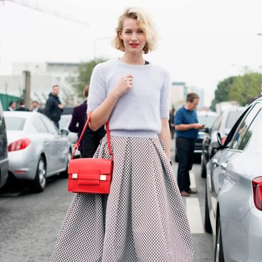 """<p>This could be one of our favourite street style looks from Paris fashion week - loving the fifties-inspired vibe of this outfit. Pairing a cropped Topshop jumper a la Grease with a volumnous mid-length skirt by Tom Maticevski and that pop of colour with a bright red bag - magnifique. </p><p><a href=""""http://www.cosmopolitan.co.uk/fashion/shopping/cosmopolitan.co.uk/fashion/shopping/milan-fashion-week-street-style"""" target=""""_blank"""">Milan Fashion Week street style</a></p><p><a href=""""http://www.cosmopolitan.co.uk/fashion/shopping/cool-street-style-at-london-fashion-week"""" target=""""_blank"""">London Fashion Week street style</a></p><p><a href=""""http://www.cosmopolitan.co.uk/fashion/winter-fashion-trends-2013/"""" target=""""_blank"""">See the latest winter fashion trends</a></p>"""