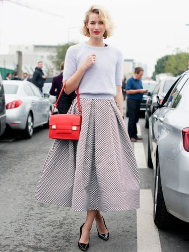 "<p>This could be one of our favourite street style looks from Paris fashion week - loving the fifties-inspired vibe of this outfit. Pairing a cropped Topshop jumper a la Grease with a volumnous mid-length skirt by Tom Maticevski and that pop of colour with a bright red bag - magnifique. </p> <p><a href=""http://www.cosmopolitan.co.uk/fashion/shopping/cosmopolitan.co.uk/fashion/shopping/milan-fashion-week-street-style"" target=""_blank"">Milan Fashion Week street style</a></p> <p><a href=""http://www.cosmopolitan.co.uk/fashion/shopping/cool-street-style-at-london-fashion-week"" target=""_blank"">London Fashion Week street style</a></p> <p><a href=""http://www.cosmopolitan.co.uk/fashion/winter-fashion-trends-2013/"" target=""_blank"">See the latest winter fashion trends</a></p>"