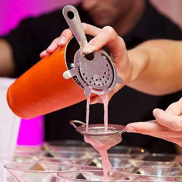 """<p><a href=""""http://www.pinkyvodka.com/wordpress/wp-content/themes/pinky/Pinky.php?redirect=/index.php"""" target=""""_blank"""">Pinky Vodka</a> creating our Cosmopolitans.</p>"""