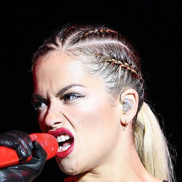 <p>Cornrow braids take the pretty plaited trend into edgy territory and Rita Ora works it with ease. The tight-to-the-head braids are not for everyone but they give the effect of a sharp silhouette without the need of scissors.</p>