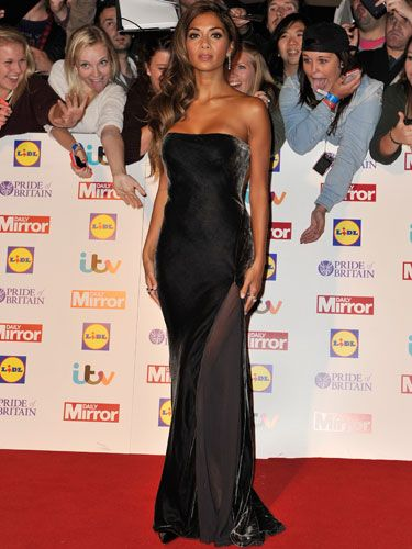 <p>She may have found fame as a singer and won us over as the sweetest judge on The X Factor but Nicole showed she's also got it when it comes to red carpet dressing. Clad in a strapless gunmetal frock complete with a sheer panel that ran from hip to hemline, she looked schmazing.</p>