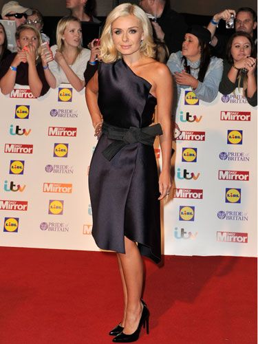 <p>The forever flawless singer performed a little fashion magic on the carpet. Her navy number was one shouldered and had a wrap over effect secured with an origami-style bow that also allowed for an asymmetric hem. It's a shame she didn't liven it up with some colourful accessories.<br /><br /></p>