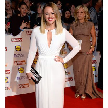 <p>It was all white on the night for Kimberley who stunned in the bright shade. Long sleeves and a floor-length hemline gave this look an elegant edge but the key hole also added just the right layer of sexiness. Go Kim!</p>