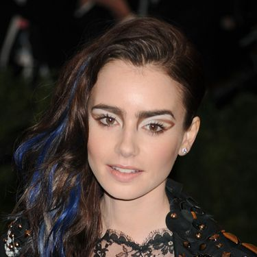 """<p>Lily Collins made the style badass, not with braids, but with blue streaks. This is our Halloween hair sorted then.</p><p><a href=""""http://www.cosmopolitan.co.uk/beauty-hair/styles/celebrity/cosmo-hairstyle-of-the-day"""" target=""""_blank"""">HAIRSTYLE OF THE DAY</a></p><p><a href=""""http://www.cosmopolitan.co.uk/beauty-hair/news/styles/celebrity/frow-hair-celebrity-fashion-week"""" target=""""_blank"""">FRONT ROW HAIRSTYLES </a></p><p><a href=""""http://www.cosmopolitan.co.uk/beauty-hair/"""" target=""""_blank"""">MORE CELEBRITY HAIR NEWS </a></p><p> </p>"""