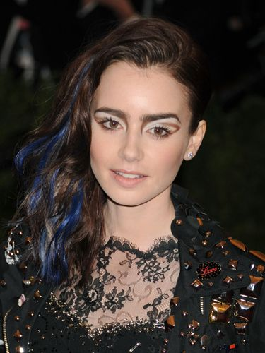 "<p>Lily Collins made the style badass, not with braids, but with blue streaks. This is our Halloween hair sorted then.</p> <p><a href=""http://www.cosmopolitan.co.uk/beauty-hair/styles/celebrity/cosmo-hairstyle-of-the-day"" target=""_blank"">HAIRSTYLE OF THE DAY</a></p> <p><a href=""http://www.cosmopolitan.co.uk/beauty-hair/news/styles/celebrity/frow-hair-celebrity-fashion-week"" target=""_blank"">FRONT ROW HAIRSTYLES </a></p> <p><a href=""http://www.cosmopolitan.co.uk/beauty-hair/"" target=""_blank"">MORE CELEBRITY HAIR NEWS </a></p> <p> </p>"