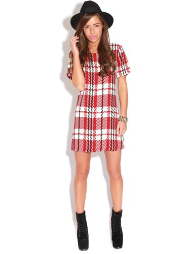 "<p>If you've been paying attention to our <a href=""http://www.cosmopolitan.co.uk/fashion/winter-fashion-trends-2013/"" target=""_blank"">winter trends advice,</a> you'll know that checks are where it's at this season. The jumbo plaid on this style looks super luxe.</p> <p>Check shift dress, £20, <a href=""http://www.prettylittlething.com/bridie-red-and-white-aztec-shift-dress.html"" target=""_blank"">prettylittlething.com</a></p> <p><a href=""http://www.cosmopolitan.co.uk/fashion/shopping/winter-coats-less-than-50-pounds"" target=""_blank"">SHOP WINTER COATS FOR £50 OR LESS</a></p> <p><a href=""http://www.cosmopolitan.co.uk/fashion/shopping/what-to-wear-to-winter-wedding"" target=""_blank"">WHAT TO WEAR TO A WINTER WEDDING</a></p> <p><a href=""http://www.cosmopolitan.co.uk/fashion/winter-fashion-trends-2013/"" target=""_blank"">SEE THE LATEST WINTER FASHION TRENDS 2013</a></p>"
