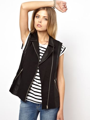 """<p>Taking the gilet from posh to rock, this faux leather alternative to the coat is perfect for not-too-blustery Autumn days in the city. Pair with black skinny jeans, shoe boots and an angora knit for a cosy, rock-chic look.</p> <p>Noisy May gilet with faux leather, £45, <a href=""""http://www.asos.com/Noisy-May/Noisy-May-Gilet-With-Faux-Leather/Prod/pgeproduct.aspx?iid=3170818&cid=2623&Rf900=3717&sh=0&pge=0&pgesize=36&sort=3&clr=Black"""" target=""""_blank"""">ASOS </a></p> <p><a href=""""http://www.cosmopolitan.co.uk/fashion/shopping/pauls-boutique-bags-winter-2013?page=1"""" target=""""_blank"""">TEN NEW HANDBAGS FOR A/W13</a></p> <p><a href=""""http://www.cosmopolitan.co.uk/fashion/news/m-and-s-best-of-british-fashion"""" target=""""_blank"""">M&S LAUNCHES BEST OF BRITISH COLLECTION</a></p> <p><a href=""""http://www.cosmopolitan.co.uk/fashion/shopping/womens-clothing-under-ten-pounds"""" target=""""_blank"""">THE PERFECT WHITE SHIRT FOR A TENNER</a></p>"""