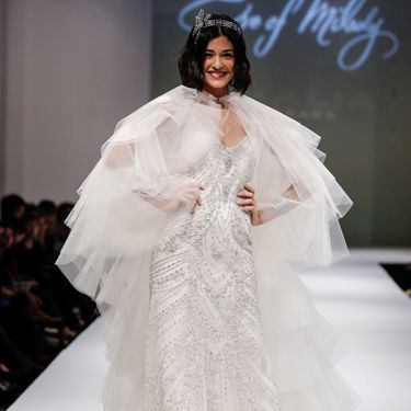 """<p>Wedding dress, check. Cape... check? Not too sure about this one, although the model seems pretty chuffed.</p><p><a href=""""http://www.cosmopolitan.co.uk/fashion/shopping/halloween-outfits"""" target=""""_blank"""">EFFORTLESS HALLOWEEN OUTFITS</a></p><p><a href=""""http://www.cosmopolitan.co.uk/fashion/shopping/new-in-store-14-oct?page=1"""" target=""""_blank"""">NEW IN STORE THIS WEEK</a></p><p><a href=""""http://www.cosmopolitan.co.uk/fashion/shopping/pauls-boutique-bags-winter-2013?page=1"""" target=""""_blank"""">TEN NEW HANDBAGS FOR A/W13</a></p>"""