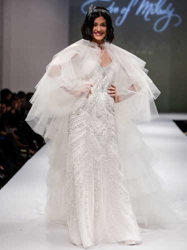 "<p>Wedding dress, check. Cape... check? Not too sure about this one, although the model seems pretty chuffed.</p> <p><a href=""http://www.cosmopolitan.co.uk/fashion/shopping/halloween-outfits"" target=""_blank"">EFFORTLESS HALLOWEEN OUTFITS</a></p> <p><a href=""http://www.cosmopolitan.co.uk/fashion/shopping/new-in-store-14-oct?page=1"" target=""_blank"">NEW IN STORE THIS WEEK</a></p> <p><a href=""http://www.cosmopolitan.co.uk/fashion/shopping/pauls-boutique-bags-winter-2013?page=1"" target=""_blank"">TEN NEW HANDBAGS FOR A/W13</a></p>"