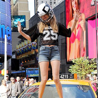 """<p>The It model gets in on the NFL-themed action, showing off her best victory dance moves - again, atop a yellow cab - wearing a massive helmet. <br /><br />Ugh, a regular dancefloor seems so MUNDANE to us now.</p><p><a href=""""http://www.cosmopolitan.co.uk/beauty-hair/news/hairstyles/cara-delevingne-40s-hair-brazil?click=main_sr"""" target=""""_blank"""">CARA DELEVINGNE MAKES WAVES WITH 40s HAIR</a></p><p><a href=""""http://www.cosmopolitan.co.uk/fashion/news/cara-delevingne-gorilla-trainers-brazil?click=main_sr"""" target=""""_blank"""">CARA DELEVINGNE'S CRAZY GORILLA TRAINERS</a></p><p><a href=""""http://www.cosmopolitan.co.uk/celebs/entertainment/cara-delevingne-amanda-knox-film?click=main_sr"""" target=""""_blank"""">CARA DELEVINGNE SIGNS UP TO STAR IN NEW AMANDA KNOX FILM</a></p>"""