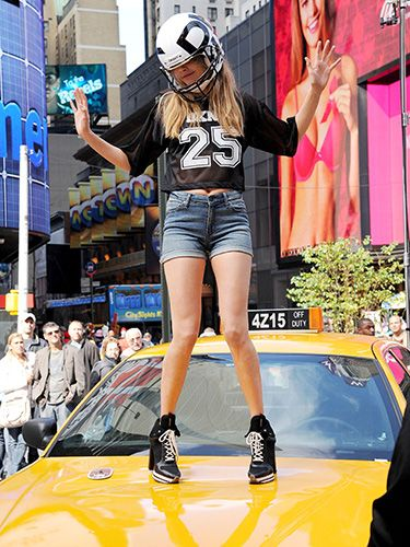 """<p>The It model gets in on the NFL-themed action, showing off her best victory dance moves - again, atop a yellow cab - wearing a massive helmet. <br /><br />Ugh, a regular dancefloor seems so MUNDANE to us now.</p> <p><a href=""""http://www.cosmopolitan.co.uk/beauty-hair/news/hairstyles/cara-delevingne-40s-hair-brazil?click=main_sr"""" target=""""_blank"""">CARA DELEVINGNE MAKES WAVES WITH 40s HAIR</a></p> <p><a href=""""http://www.cosmopolitan.co.uk/fashion/news/cara-delevingne-gorilla-trainers-brazil?click=main_sr"""" target=""""_blank"""">CARA DELEVINGNE'S CRAZY GORILLA TRAINERS</a></p> <p><a href=""""http://www.cosmopolitan.co.uk/celebs/entertainment/cara-delevingne-amanda-knox-film?click=main_sr"""" target=""""_blank"""">CARA DELEVINGNE SIGNS UP TO STAR IN NEW AMANDA KNOX FILM</a></p>"""
