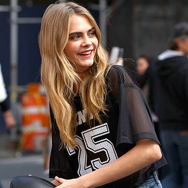 """<p>Keeping with the American football theme, Cara goes in for a long pass in this candid shot.</p><p><a href=""""http://www.cosmopolitan.co.uk/beauty-hair/news/hairstyles/cara-delevingne-40s-hair-brazil?click=main_sr"""" target=""""_blank"""">CARA DELEVINGNE MAKES WAVES WITH 40s HAIR</a></p><p><a href=""""http://www.cosmopolitan.co.uk/fashion/news/cara-delevingne-gorilla-trainers-brazil?click=main_sr"""" target=""""_blank"""">CARA DELEVINGNE'S CRAZY GORILLA TRAINERS</a></p><p><a href=""""http://www.cosmopolitan.co.uk/celebs/entertainment/cara-delevingne-amanda-knox-film?click=main_sr"""" target=""""_blank"""">CARA DELEVINGNE SIGNS UP TO STAR IN NEW AMANDA KNOX FILM</a></p>"""