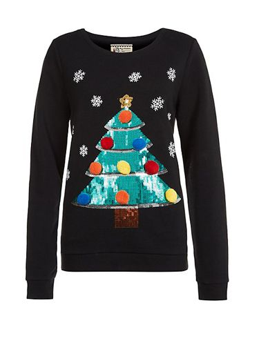 "<p>Gather all your presents in just one jumper - we love the bright sequins against the black knit.</p> <p>Christmas jumper, £24.99, <a href=""http://www.newlook.com/shop/womens/knitwear/cream-reindeer-fluffy-christmas-jumper_288704212"" target=""_blank"">New Look</a></p> <p><a href=""http://www.cosmopolitan.co.uk/fashion/shopping/christmas-jumpers-2013-primark-womens"" target=""_blank"">PRIMARK'S CHRISTMAS JUMPERS ARE OUT</a></p> <p><a href=""http://www.cosmopolitan.co.uk/fashion/shopping/halloween-outfits"" target=""_blank"">EFFORTLESS HALLOWEEN OUTFITS FROM THE HIGH STREET</a></p> <p><a href=""http://www.cosmopolitan.co.uk/fashion/shopping/celebrity-winter-coat-inspiration"" target=""_blank"">CELEBRITY WINTER COAT INSPIRATION</a></p>"