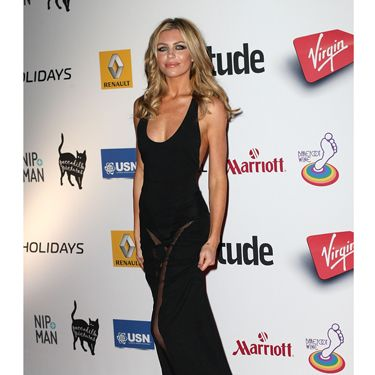 <p>Britain's Next Top Model winner and ultimate WAG Abbey Clancy looked every bit glamourous in a simple black maxi dress with a sexy sheer panel at the front, showing off her enviable long pins.</p>
