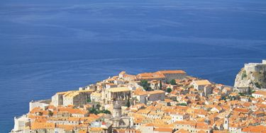 """<p>Dubrovnik Old Town – the heart of the city – has some serious medieval beauty on offer. Got some energy? Try walking the city walls. We signed up for a <a href=""""http://www.viator.com/tours/Dubrovnik/Viator-Exclusive-Game-of-Thrones-Walking-Tour-of-Dubrovnik/d904-5360GAMETHRONES"""">Game of Thrones tour</a> (yep, for real!) If you're a fan of the show this is the perfect way to explore without feeling like you're in a very hot history lesson. Our GOT-obsessed guide showed us stills from the show and I forced my boyfriend to take pictures of me shouting, """"where are my dragons?!"""" at the exterior of The House of the Undying - don't judge. In the evening, make it your mission to find the 'hidden bars', Buza Bar 1 and Buza Bar 2; cliff-edge drinkeries with amazing views and chilled-out music. Bliss.</p>"""
