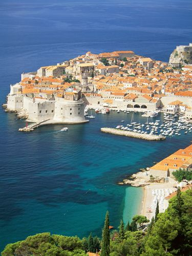 """<p>Dubrovnik Old Town – the heart of the city – has some serious medieval beauty on offer. Got some energy? Try walking the city walls. We signed up for a <a href=""""http://www.viator.com/tours/Dubrovnik/Viator-Exclusive-Game-of-Thrones-Walking-Tour-of-Dubrovnik/d904-5360GAMETHRONES"""">Game of Thrones tour</a> (yep, for real!) If you're a fan of the show this is the perfect way to explore without feeling like you're in a very hot history lesson. Our GOT-obsessed guide showed us stills from the show and I forced my boyfriend to take pictures of me shouting, """"where are my dragons?!"""" at the exterior of The House of the Undying - don't judge. In the evening, make it your mission to find the 'hidden bars', Buza Bar 1 and Buza Bar 2&#x3B; cliff-edge drinkeries with amazing views and chilled-out music. Bliss.</p>"""