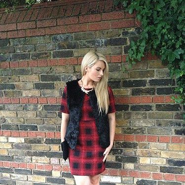 """<p>My favourite autumn/winter outfit is from Dorothy Perkins – a red plaid dress with a faux fur gilet.</p><p>Outfit: Dress – Dorothy Perkins, Leather Jacket – New Look, Faux Fur Gilet – Dorothy Perkins, Boots – last season, Necklace – A
