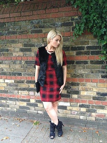 <p>My favourite autumn/winter outfit is from Dorothy Perkins – a red plaid dress with a faux fur gilet.</p>