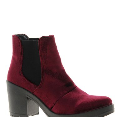 <p>Channel your inner goth with these chunky dark berry velvet boots from ASOS, à la Made In Chelsea's Phoebe Lettice Thompson. Pair with black skinny jeans, an oversized black knit and a sheepskin coat for that winter-grunge look.</p>