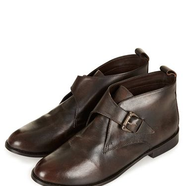 <p>Thanks to Russell & Bromley, the masculine monk strap style is back in fashion - and we love this old-school vintage pair from Topshop. Flat yet flirty and bang on trend. Find your inner Victorian and style her up with a tartan mini and boyfriend-fit tee.</p>