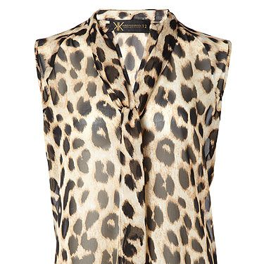 """<p>Leopard pussy bow blouse, £40 </p><p><a href=""""http://www.cosmopolitan.co.uk/beauty-hair/news/beauty-news/kardashian-sisters-launch-debut-makeup-collection-khroma-beauty-boldface"""" target=""""_blank"""">KARDASHIAN BEAUTY LINE LAUNCHES IN THE UK</a></p><p><a href=""""http://www.cosmopolitan.co.uk/celebs/celebrity-gossip/kanye-west-kim-kardashian-selfie"""" target=""""_blank"""">KIM KARDASHIAN'S BOOTYLICIOUS POST-BABY SELFIE</a></p><p><a href=""""http://www.cosmopolitan.co.uk/beauty-hair/news/trends/celebrity-beauty/kardashains-beauty-and-body-secret-organic-coconut-oil"""" target=""""_blank"""">THE KARDASHIAN SHARES BEAUTY TIPS</a></p>"""