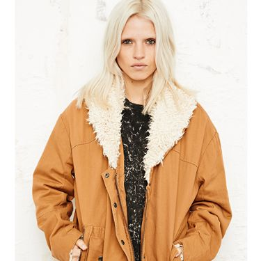 <p>The mild autumn breeze will inevitably be turning into the icy, arctic winds we have come to know as the British winter. So wrap up in this rust-coloured sherpa jacket. Its oversized fit is relaxed and vintage, as well as being practical allowing you to wear a thick knit under for extra warmth!</p>
