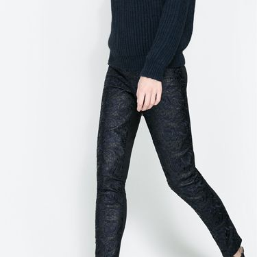 <p>We are a little bit in love with these faux leather trousers, featuring a brocade leather pattern at the front, and cotton legging material at the back for extra comfort. Flat black boots and a chunky knit is all you need to complete the outfit.</p>