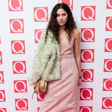 <p>Eliza Doolittle is becoming a bit of a feature on the red carpet these days. We love her pink slip dress by Antipodium and her green fluffy shoulder accessory (we're pretty sure it's a jacket...)</p>