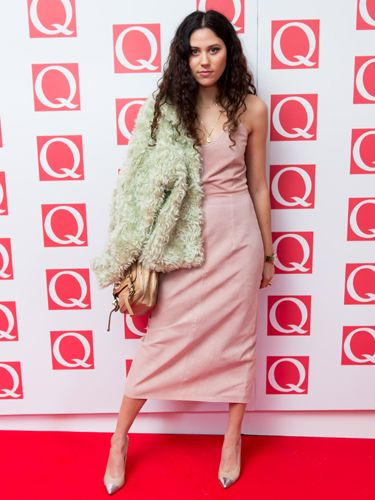 """<p>Eliza Doolittle is becoming a bit of a feature on the red carpet these days. We love her pink slip dress by Antipodium and her green fluffy shoulder accessory (we're pretty sure it's a jacket...)</p> <p><a href=""""http://www.cosmopolitan.co.uk/fashion/celebrity/best-dressed-celebrities-18-october"""" target=""""_blank"""">BEST DRESSED CELEBRITIES </a></p> <p><a href=""""http://www.cosmopolitan.co.uk/fashion/celebrity/best-dressed-mobo-awards"""" target=""""_blank"""">BEST DRESSED AT THE MOBO AWARDS</a></p> <p><a href=""""http://www.cosmopolitan.co.uk/fashion/celebrity/best-dress-attitude-awards"""" target=""""_blank"""">BEST DRESSED AT THE ATTITUDE AWARDS</a></p>"""