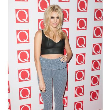 <p>Showing off her petite frame and toned tum, Pixie paired a simple black crop-top with gingham-peplum leggings - a combination we thought would never work, but somehow, Pixie manages to pull together! </p>