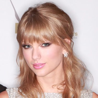"""<p>Taylor Swift (pictured), Suki Waterhouse, Millie Mackintosh and Lily Allen are doing this season's full fringes oh-so-well. Slightly chopping in cut and lash-kissing in length, the new bangs are soft and sultry. We love.</p><p><a href=""""http://www.cosmopolitan.co.uk/beauty-hair/news/styles/celebrity/face-framing-fringes-hair-trend"""" target=""""_blank"""">SEE MORE CELEBS WITH COOL FRINGES</a> </p>"""