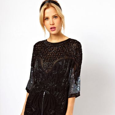 <p>Channel 1920s-inspired chic in this beaded and sequinned embellished long-sleeved flapper dress by ASOS. Accessorise with drop-down earrings and a small box-cluth for instant Great Gatsby glamour.</p>