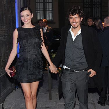 """<p>A pregnant Miranda held hands with Orlando exiting a Fashion Week show in Milan in 2010. Chicest mum-to-be we've ever seen...</p><p><a href=""""http://www.cosmopolitan.co.uk/celebs/celebrity-gossip/miranda-kerr-orlando-bloom-split"""" target=""""_blank"""">MIRANDA KERR AND ORLANDO BLOOM SPLIT</a></p><p><a href=""""http://www.cosmopolitan.co.uk/fashion/shopping/miranda-kerr-mango-winter-collection"""" target=""""_blank"""">MIRANDA KERR MODELS MANGO WINTER 2013 COLLECTION</a></p><p><a href=""""http://www.cosmopolitan.co.uk/celebs/celebrity-gossip/"""" target=""""_blank"""">GET MORE CELEBRITY NEWS</a></p>"""
