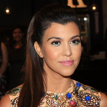 <p>Kourtney Kardashian has paired amazing 60s makeup with the modern trend for sleek hair. The supersized feather lashes – top <em>and</em> bottom – look amazing with a slick of blue liner and pale pink lippy.</p>