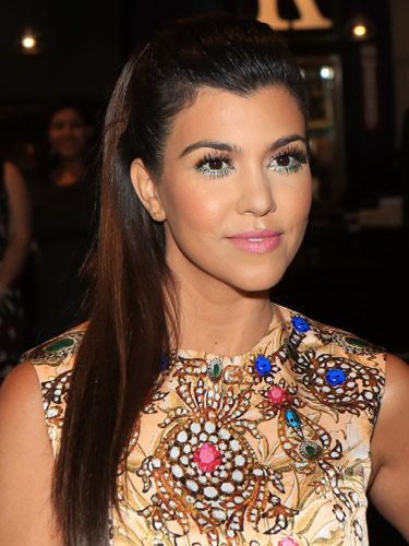 "<p>Kourtney Kardashian has paired amazing 60s makeup with the modern trend for sleek hair. The supersized feather lashes – top <em>and</em> bottom – look amazing with a slick of blue liner and pale pink lippy.</p> <p><a href=""http://www.cosmopolitan.co.uk/beauty-hair/news/styles/celebrity/cosmo-hairstyle-of-the-day"" target=""_blank"">COSMO'S HAIRSTYLE OF THE DAY</a></p> <p><a href=""http://www.cosmopolitan.co.uk/beauty-hair/news/styles/celebrity/frow-hair-celebrity-fashion-week"" target=""_blank"">FRONT ROW HAIRSTYLES WE LOVE</a></p> <p><a href=""http://www.cosmopolitan.co.uk/beauty-hair/news/styles/celebrity/"" target=""_blank"">MORE CELEBRITY HAIR IDEAS</a></p>"